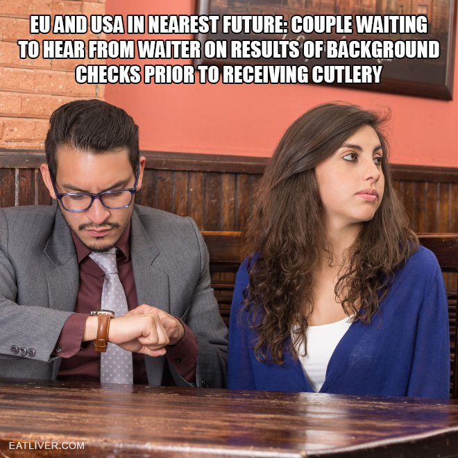 Couple waiting to hear from waiter on results of background checks prior to receiving cutlery.
