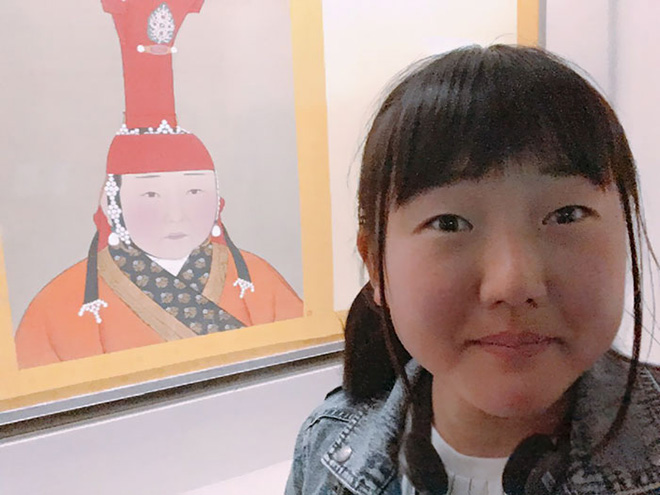 Asian girl and her painting doppelgänger.
