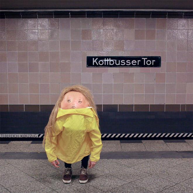 Creepy body art creature in the subway.