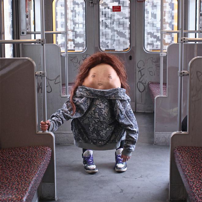 Creepy body art creature in the bus.