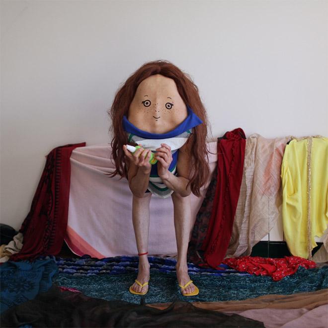 Creepy body art creature standing in the bedroom.
