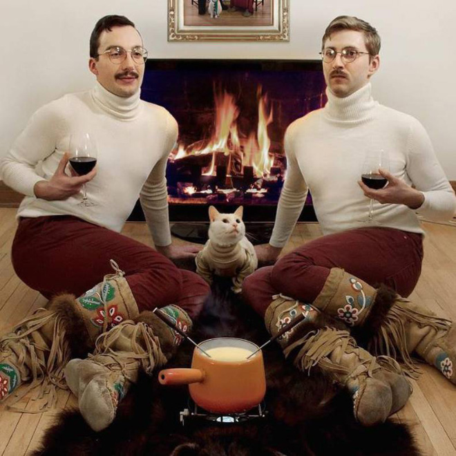 Just hanging out together in front of a fireplace.