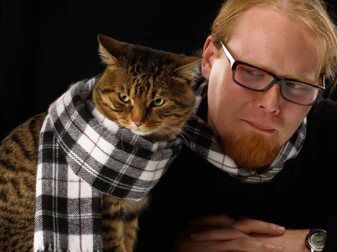 Posing with a cat in matching scarfs. Beautiful.