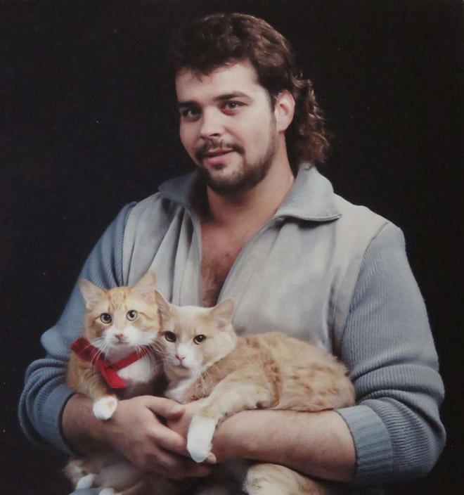 Beautiful man posing with beautiful cats.