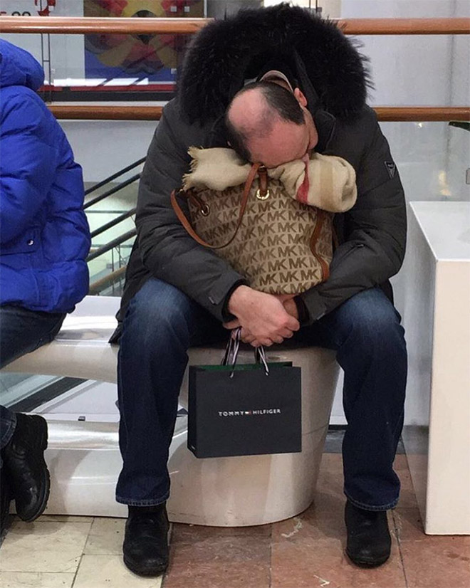 Miserable man trapped in the shopping hell.