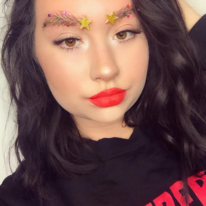 Resting bitch face + Christmas tree eyebrows.