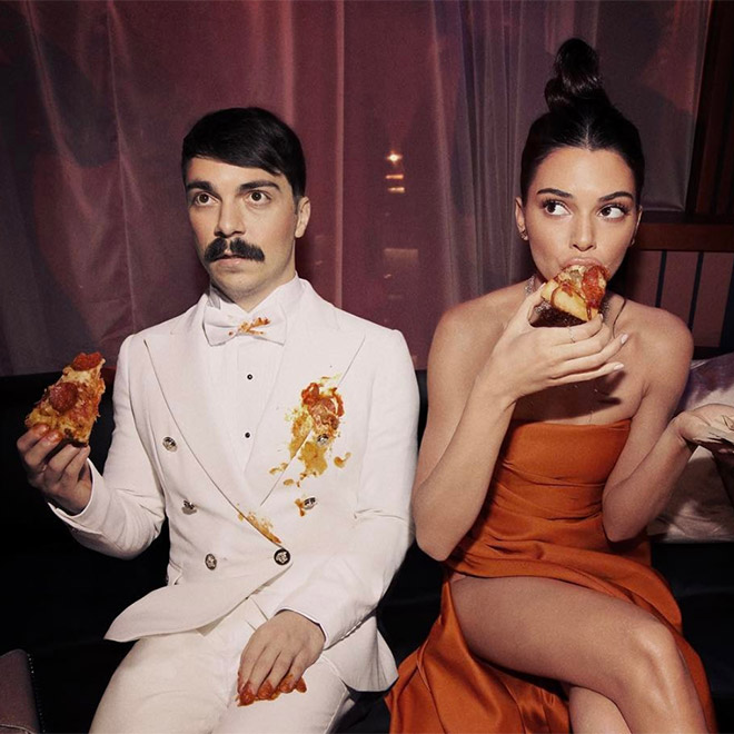 Kendall Jenner and Kirby eating pizza.