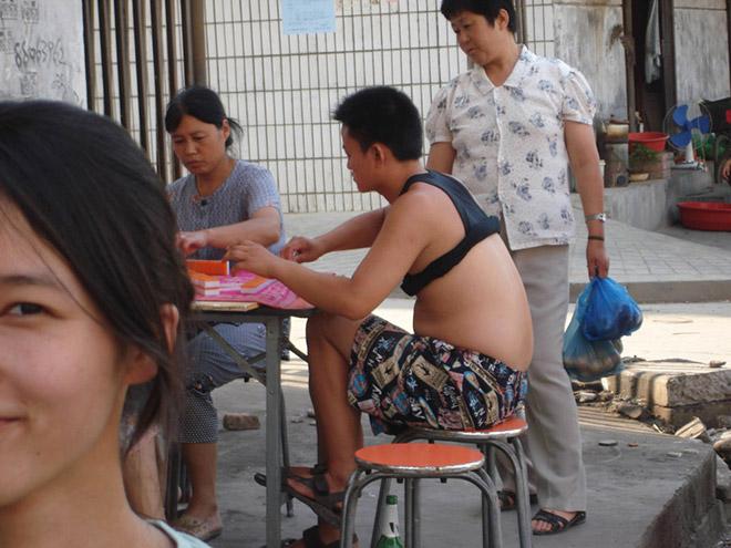 Guy wearing a Beijing bikini.