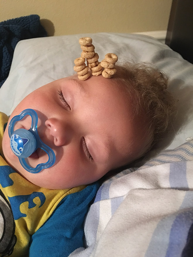 Weird viral trend: stacking Cheerio on babies.