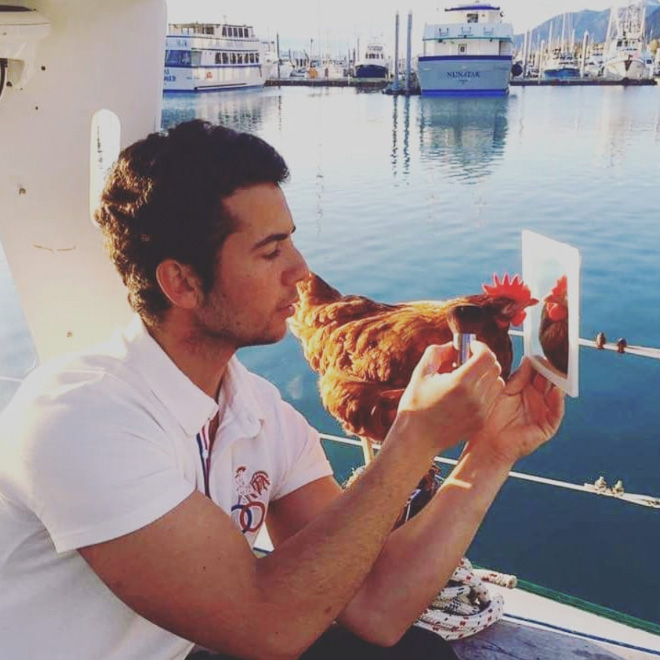 Sailing together with a pet chicken.